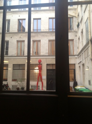 Funny red naked guy staring at the Beaucoup guests from the outside :)