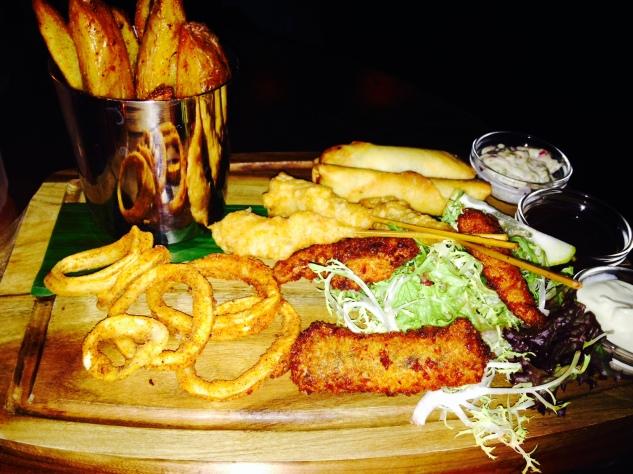 Seafood platter: calamaris, chili wedges, spring rolls, shrimps, sauces
